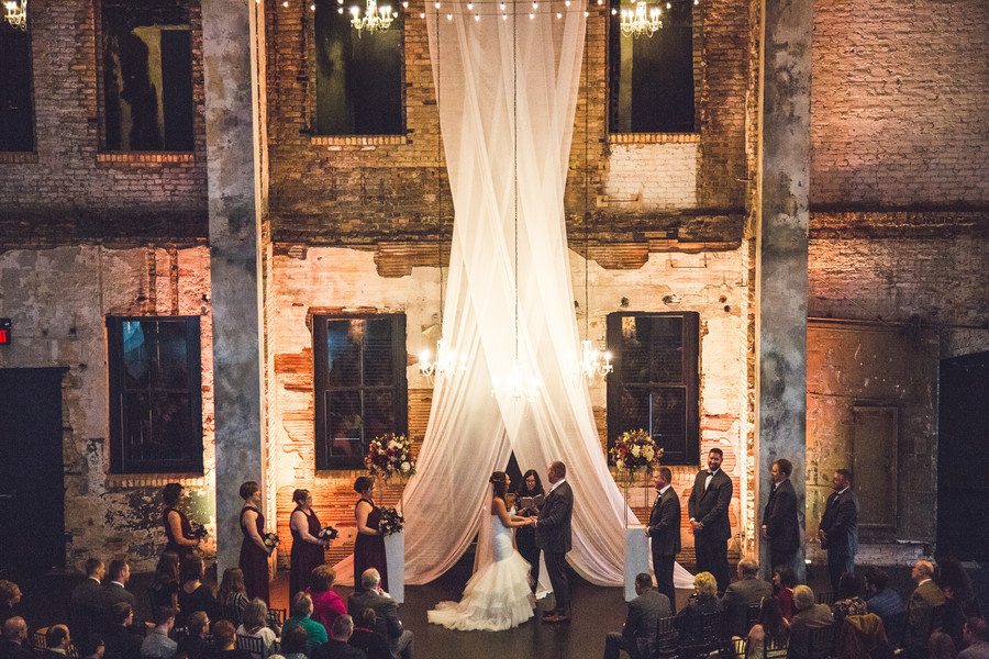 Fabric suspended from ceiling at wedding ceremony