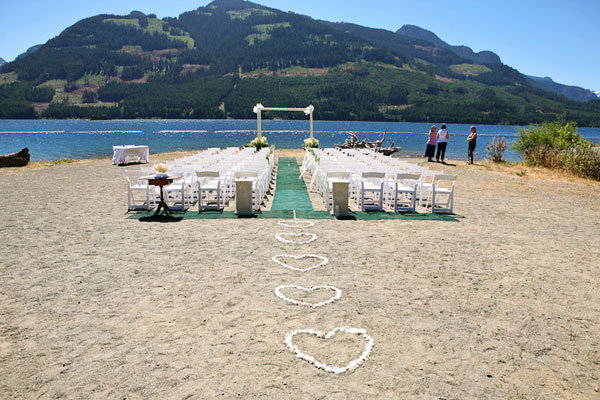 Why We Love It We love this romantic ceremony setup plus the background is