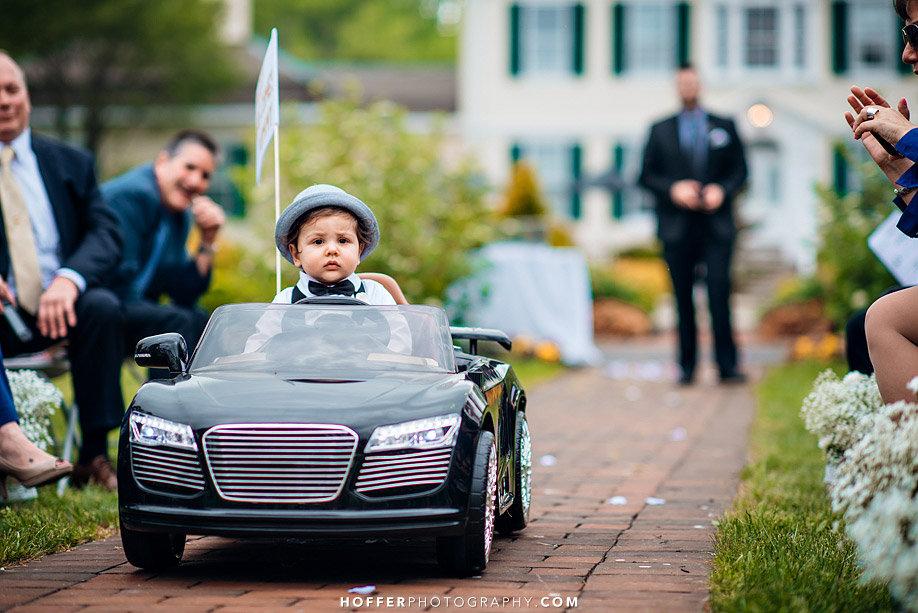 ring bearer driving down the aisle