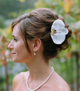Side Profile Wedding Hair Updo with white flower