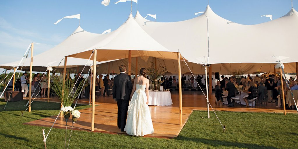 bride and groom in tent