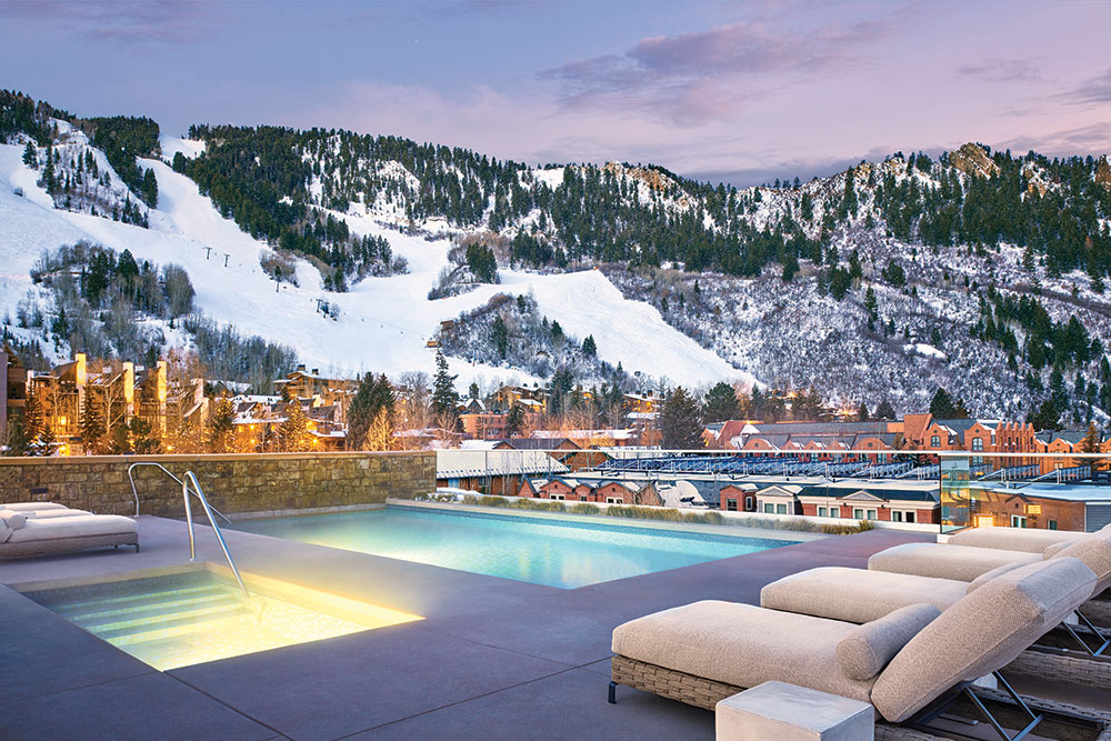 Aspen Colorado pool with snow covered mountains