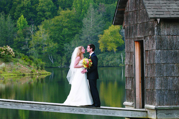 bride and groom on a lake