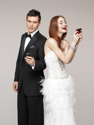 bride and groom on cell phone