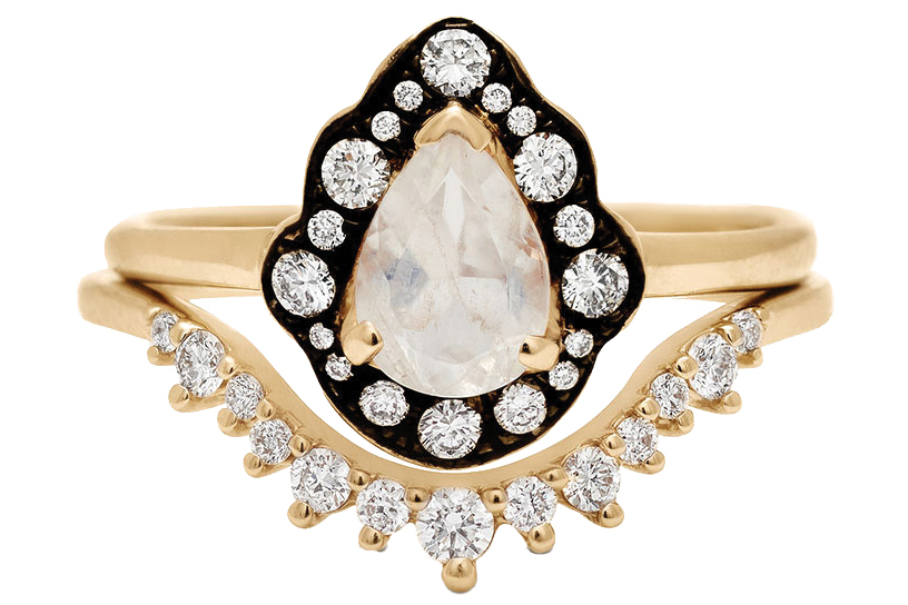 Pear-shaped moonstone ring 14k yellow gold diamond band both by Anna Sheffield