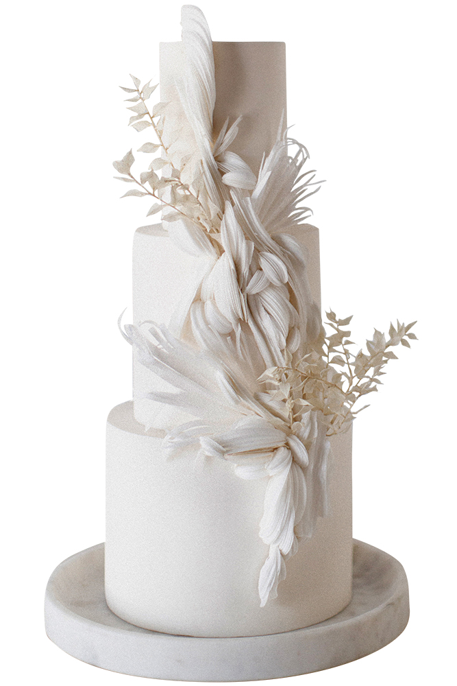 Three-tier feather-accented cake by Hey there, Cupcake
