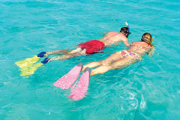 couple snorkling in antigua