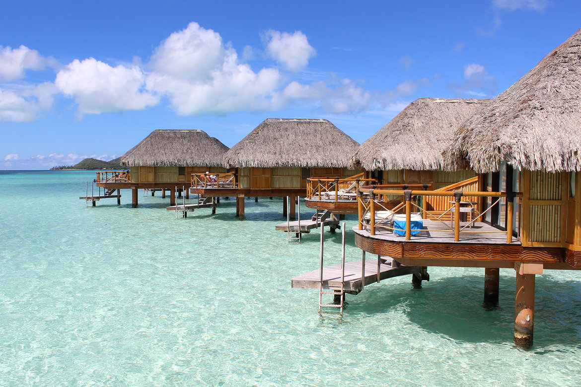 Plan the ultimate fantasy honeymoon in french polynesia for Honeymoon huts over water