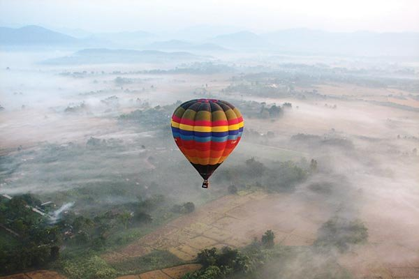 hot air balloon over the jungle of thailand