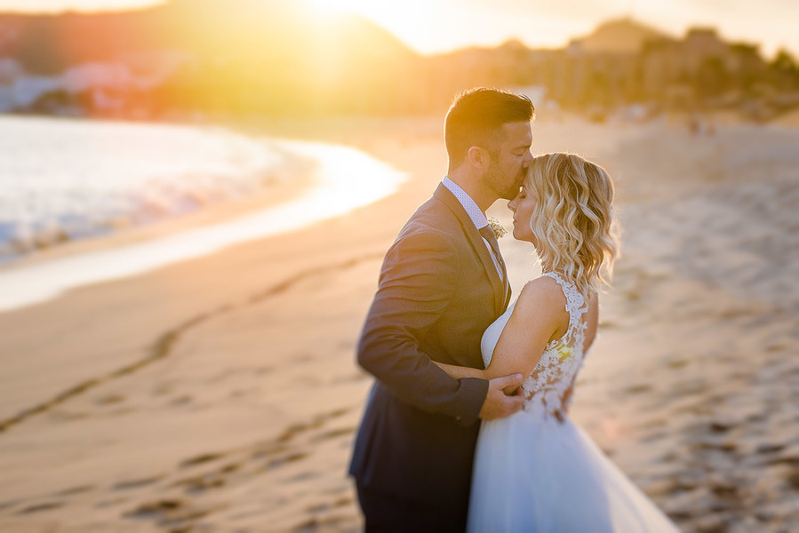 Bride and Groom Sunset Kiss on Beach