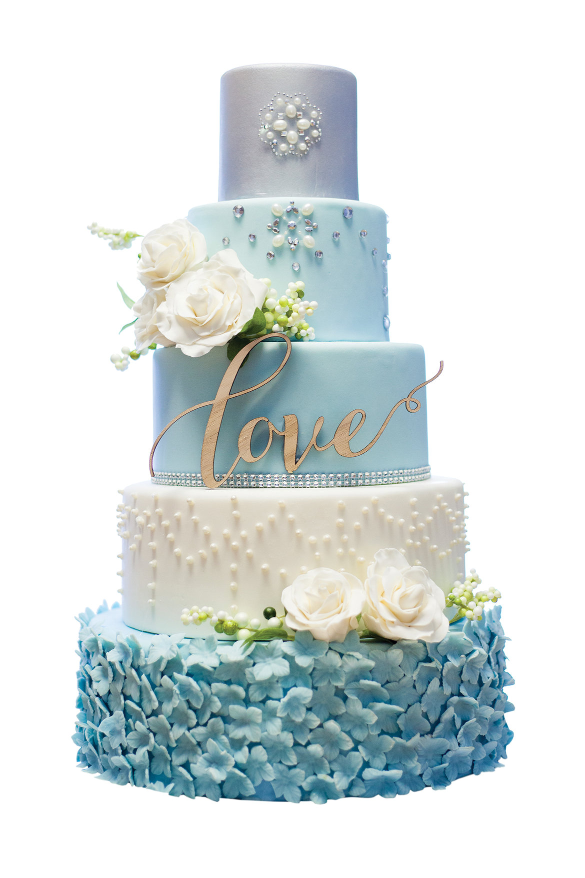 Different shades of blue icing on a 5 tier wedding cake