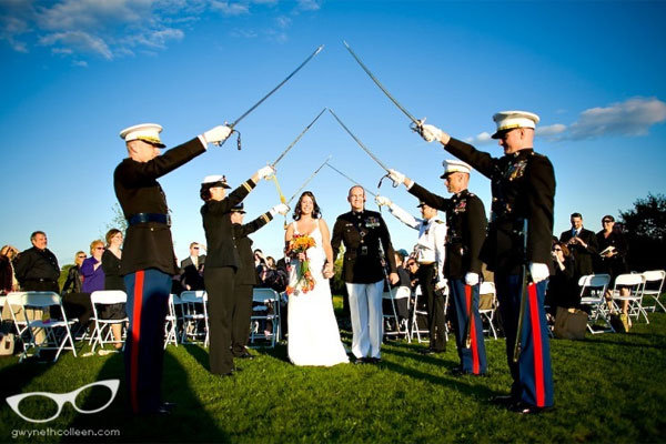 Many military weddings include a saber arch under which the bride and groom
