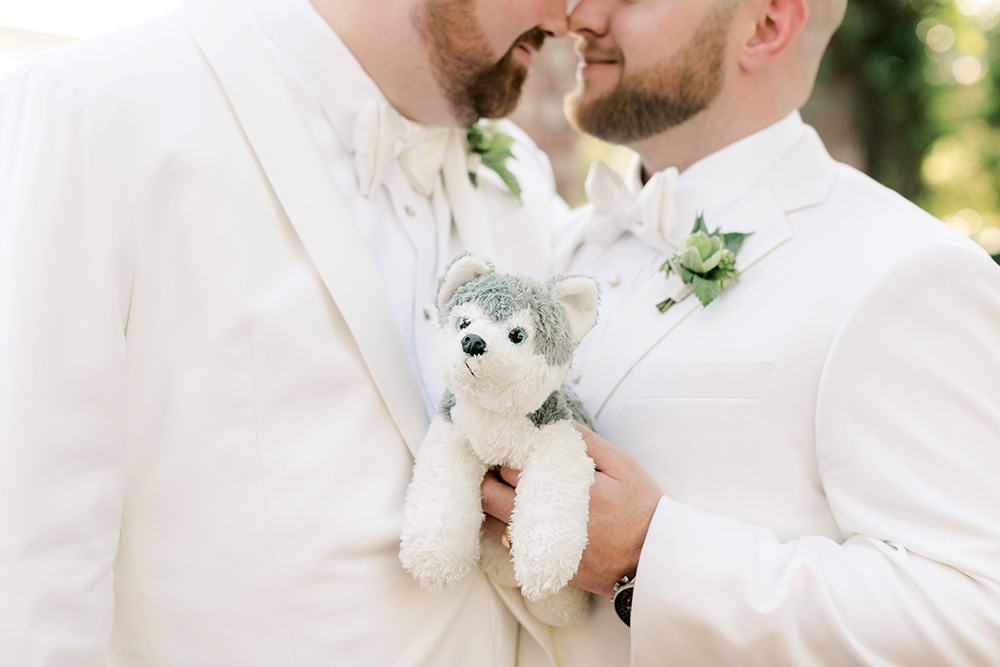 Couple with stuffed dog at wedding