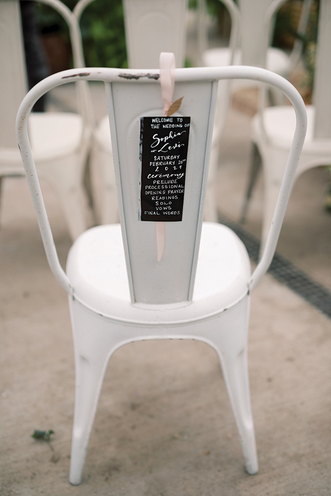 Wedding ceremony programs on chair backs