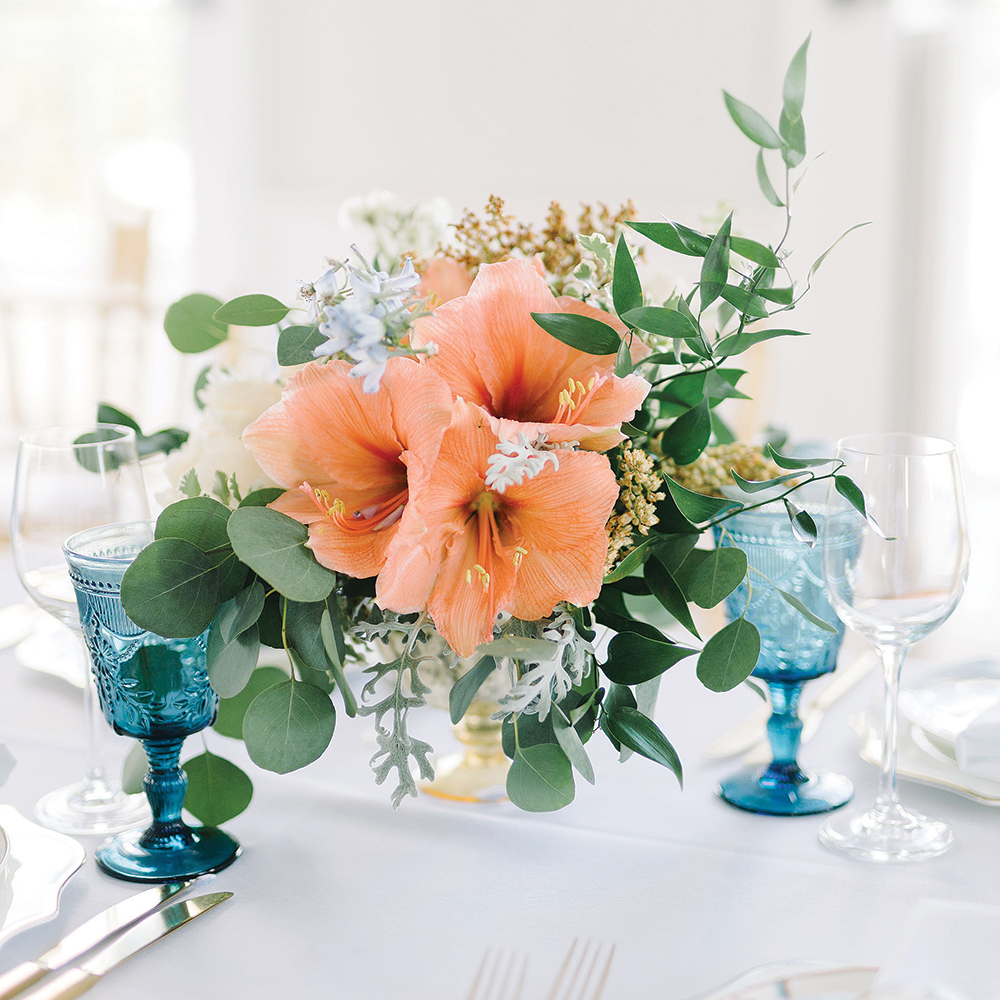Orange and blue wedding centerpiece