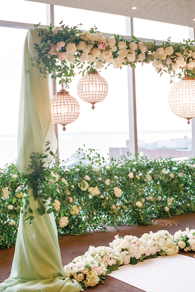 Glamorous green wedding ceremony decor