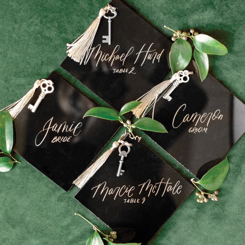 Black wedding escort cards with gold keys
