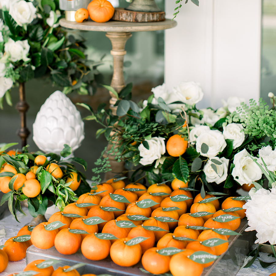 Orange fruit wedding escort card