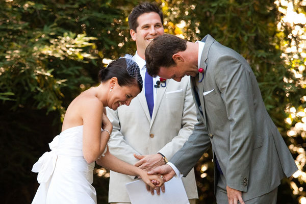 couple laughing at wedding ceremony