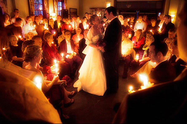 wedding guests with candles