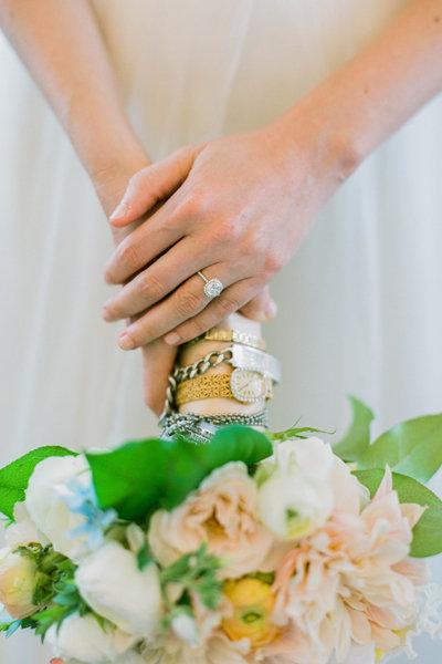 Grandmas wristwatch wrapped around bridal bouquet