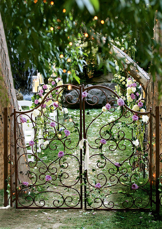 How to select your wedding flower arrangements bridalguide for How to decorate a garden gate