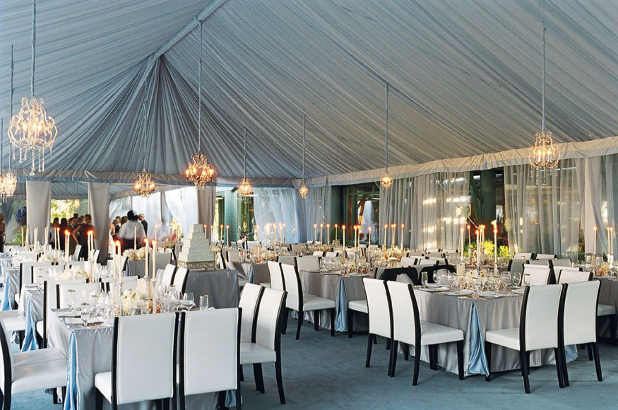 For a chic outdoor wedding in South Carolina a tent is lined with sheer