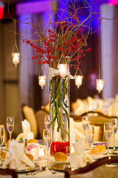 red flower centerpiece with candles
