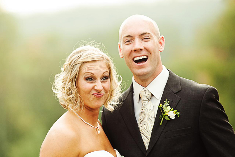 bride and groom smirking faces
