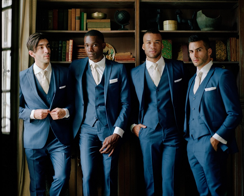 groom and groomsmen in library for Generation Tux