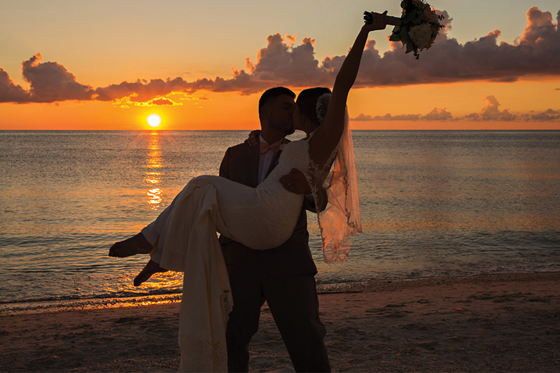 wedding couple at sunset - Naples Beach Hotel