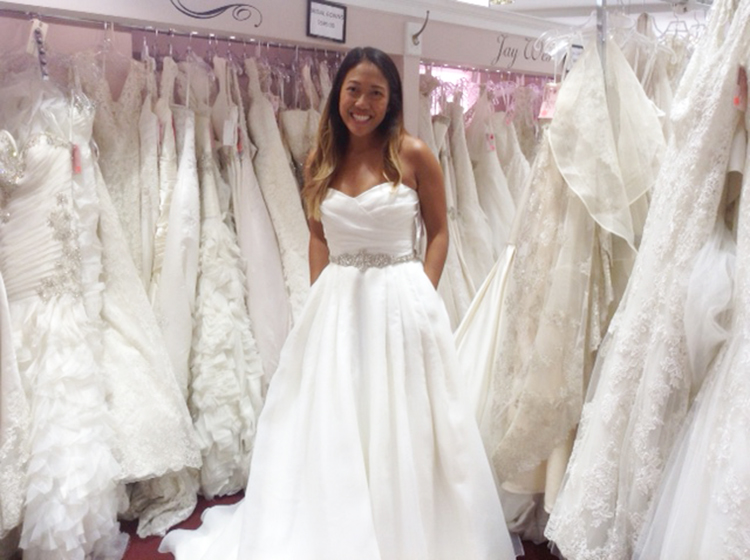 bride in wedding dress and bridal boutique