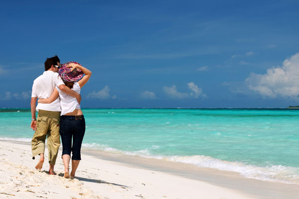 couple on beach for honeymoon