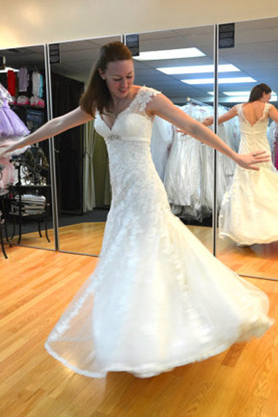 bride trying on new wedding gown