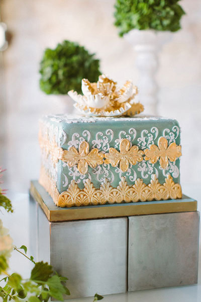 teal and gold fleur de lis inspired wedding cake