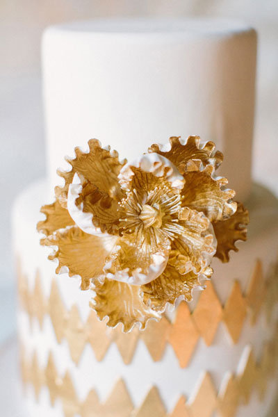 white and gold wedding cake with diamond pattern