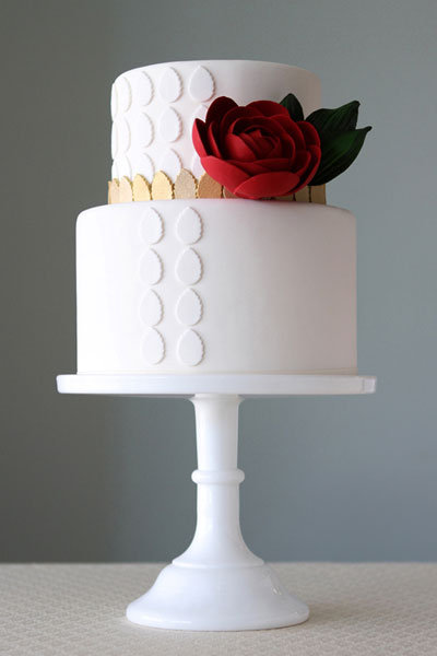 white wedding cake with red flower