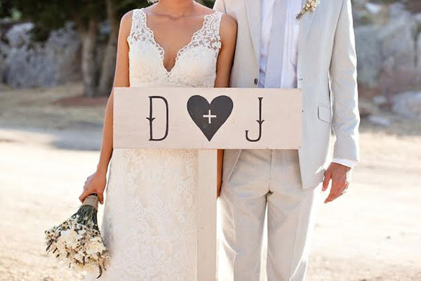 couple with rustic initial sign