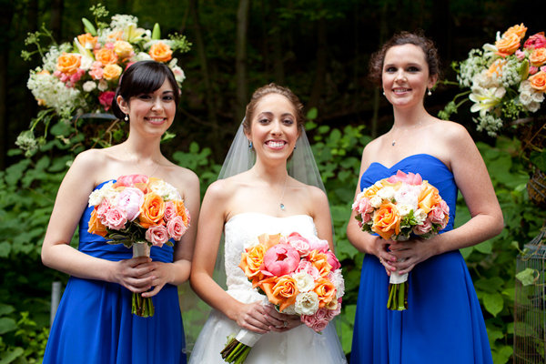The bridesmaids wore royal blue and the flowers were orange and pink