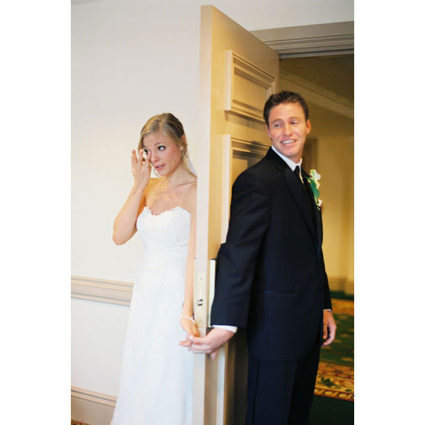 Trend alert a creative first look bridalguide couple pictured in these photos came up with the idea of holding each others hands behind a door no peeking to calm their pre wedding jitters junglespirit Images