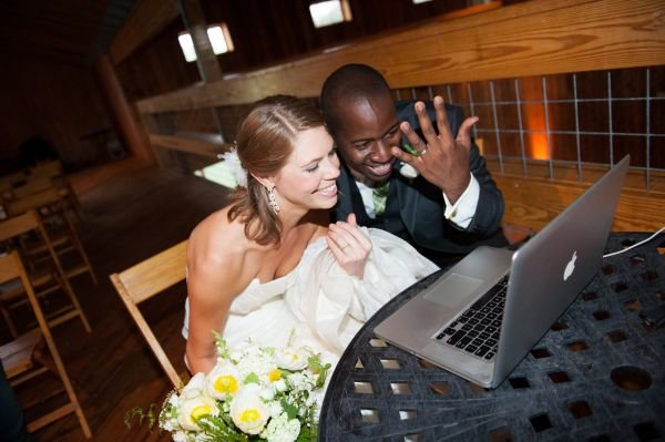 bride and groom at computer