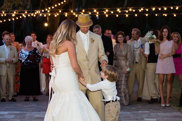 bride and groom dancing with son