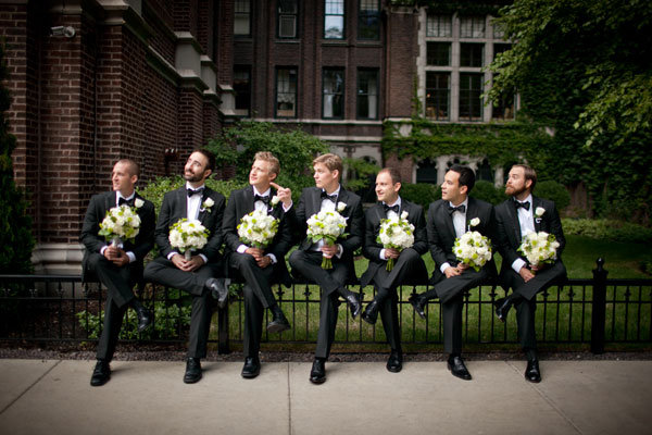 groomsmen with bouquets