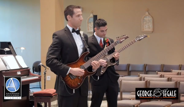 groom playing guitar during wedding ceremony