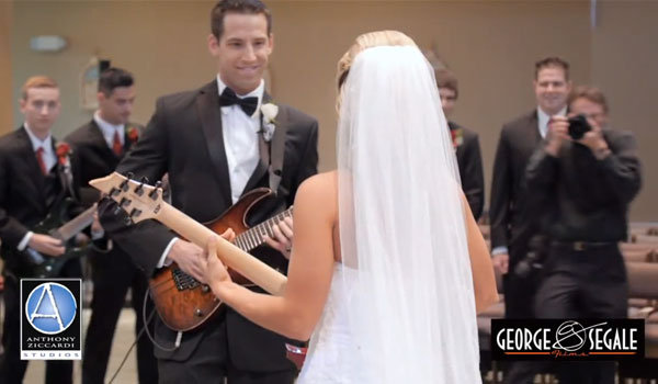 bride and groom playing guitar