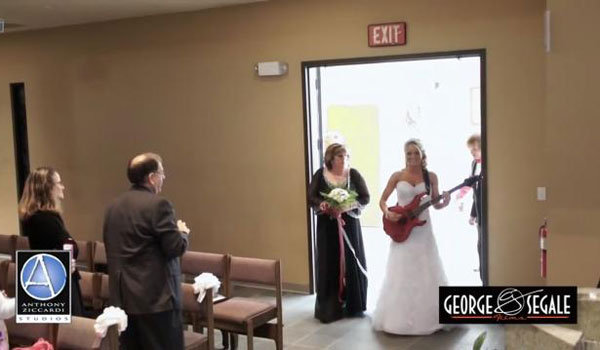bride playing guitar down the aisle