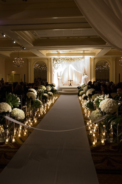 Candles And Flowers At Indoor Ceremony