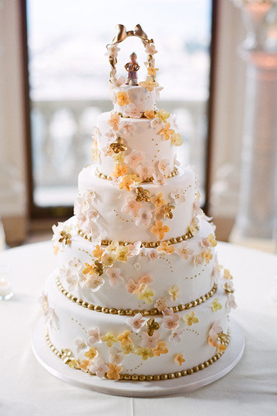 gold pink orange flowers wedding cake what to do with the top tier leftover wedding cake