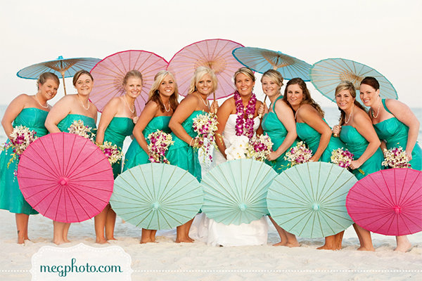 parasols for bridesmaids at beach wedding