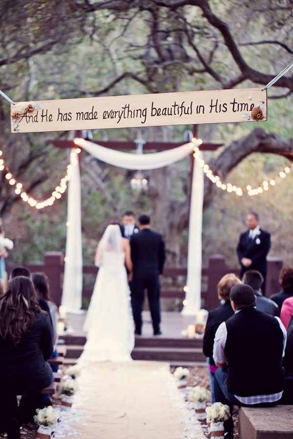 meaningful quote over the ceremony aisle